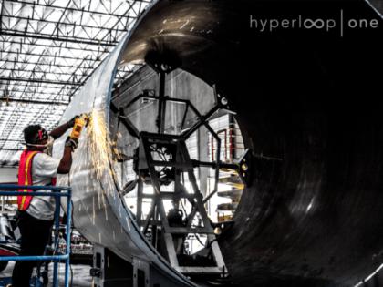 Grinding a fresh cut on one of Hyperloop's tubes at tMheir etalworks tooling shop in North Las Vegas.