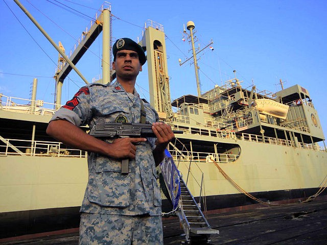 An Iranian soldier stands guard near Iranian Navy helicopter carrier Kharg at Port Sudan at the Red Sea State, October 31, 2012. REUTERS/ Mohamed Nureldin Abdallah