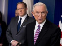 Attorney General Jeff Sessions, right, accompanied by White House press secretary Sean Spicer, second from right, talks to the media during the daily press briefing at the White House, Monday, March 27, 2017, in Washington. (AP Photo/Andrew Harnik)