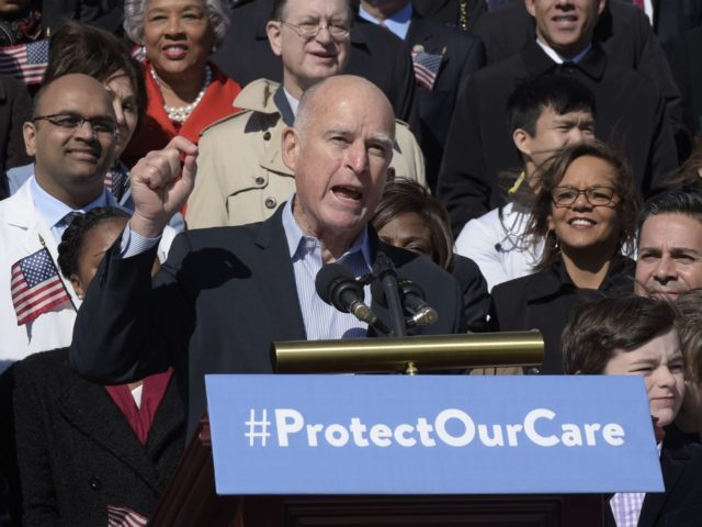 Jerry Brown Obamacare protest (Susan Walsh / Associated Press)