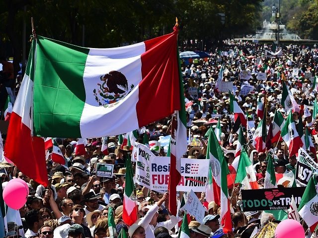 "Thousands of Mexicans take part in an anti-Trump march in Mexico City, on February 12, 2017. Mexicans took to the streets against US President Donald Trump, hitting back at his anti-Mexican rhetoric and vows to make the country pay for his ""big, beautiful"" border wall. / AFP / RONALDO SCHEMIDT …"