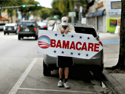 Obamacare Here Sign Joe Raedle Getty