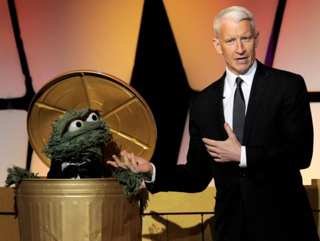 Oscar the Grouch and Anderson Cooper (Chris Pizzello / Invision / Associated Press)