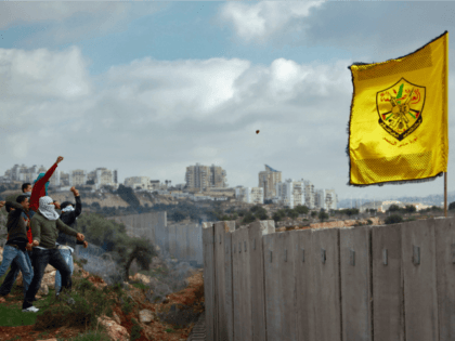 Palestinians hurl stones at Israeli troops on the other side of Israel's controversial separation barrier during a Fatah Day protest on January 1, 2010 in Ni'ilin, West Bank. Palestinians from this village marked the 45th anniversary of the founding of the Fatah faction of the PLO during their weekly demonstration …