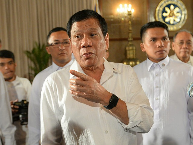 Philippine President Rodrigo Duterte (C) gestures as he talks to members of the media after a joint press conference with Senate president Aquilino Pimentel III and Speaker of the House Pantaleon Alvarez (not pictured) at Malacanang Palace in Manila on March 13, 2017. Duterte on March 13 said he agreed to Chinese ships surveying a strategic body of water despite warnings by his defence minister. TED ALJIBE / AFP