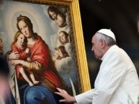 Pope Francis touches a painting depicting Virgin Mary at the end of his weekly general audience in St Peter's square at the Vatican on March 25, 2015. AFP PHOTO / GABRIEL BOUYS (Photo credit should read GABRIEL BOUYS/AFP/Getty Images)