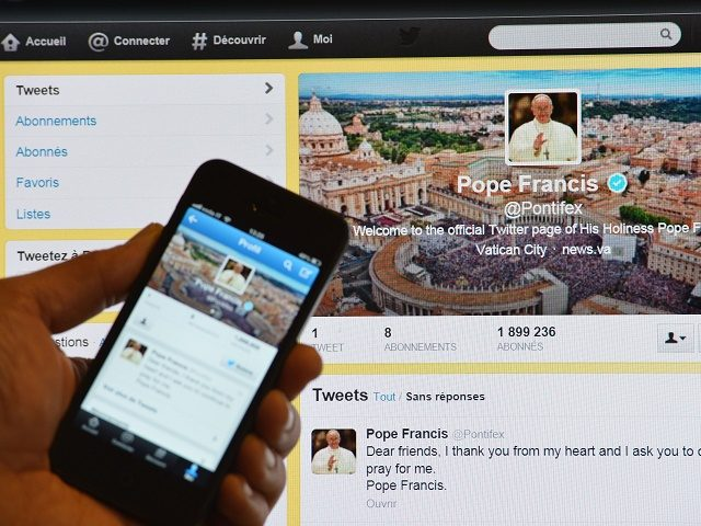 "A man holds a smartphone showing Pope Francis' first tweet in front of a computer screen showing the same tweet on March 17, 2013 in Rome. Pope Francis issued his first tweet on Sunday shortly after performing his first Angelus prayer, with a consistent message: ""Pray for me"". ""Dear friends, …"