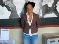 In this July 24, 2009, file photo, Rachel Dolezal, a leader of the Human Rights Education Institute, stands in front of a mural she painted at the institute's offices in Coeur d'Alene, Idaho. Dolezal, the former NAACP chapter president who made headlines in 2015 when her race came into question, …
