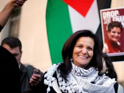 Rasmea Odeh smiles after leaving federal court in Detroit Thursday, March 12, 2015. A judge sentenced the Chicago activist to 18 months in federal prison Thursday for failing to disclose her convictions for bombings in Israel when she applied to be a U.S. citizen. Odeh, 67, also was stripped of …