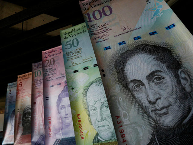 Samples of Venezuela's currencies are displayed at the Central Bank building in Caracas February 10, 2015. REUTERS/Jorge Silva