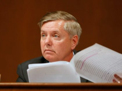 Sen. Lindsay Graham, D-S.C., quotes Supreme Court nominee Sonia Sotomayor's oft-criticized remark about her Hispanic heritage affecting judicial decisions, as she testifies on Capitol Hill in Washington, Tuesday, July 14, 2009, before the Senate Judiciary Committee. (AP Photo/Gerald Herbert)