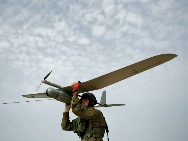 In this Sunday, March 16, 2014 photo, An Israeli soldier prepares to launch a Skylark drone for a reconnaissance mission over the Hamas held Gaza Strip, near the Israel and Gaza border. (AP Photo/Tsafrir Abayov)