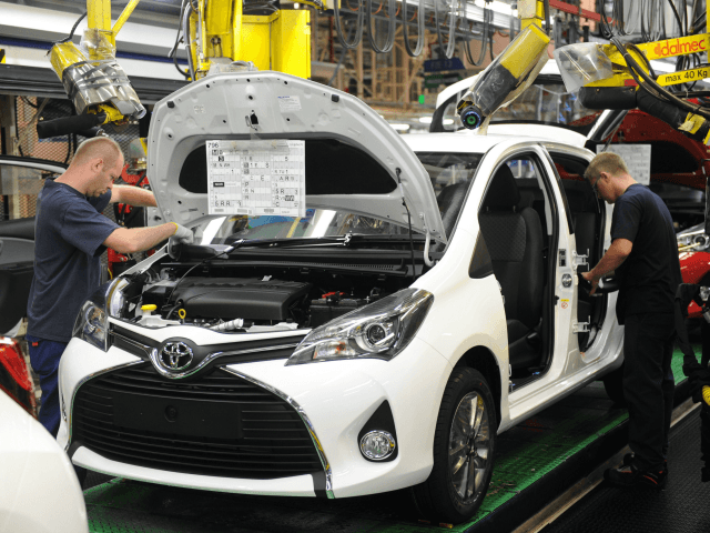 mployees are at work on the assembly line of the Toyota Yaris, on June 30, 2015 at the Toyota plant in Onnaing, northern France.