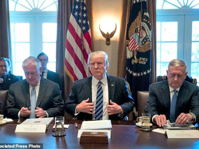 President Donald Trump, center, accompanied by Secretary of State Rex Tillerson, left, and Defense Secretary Jim Mattis, right, meets with members of his Cabinet in the Cabinet Room at the White House, Monday, March 13, 2017, in Washington. (AP Photo/Andrew Harnik)