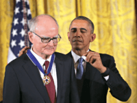 U.S. President Barack Obama (R) presents the Presidential Medal of Freedom to William Ruckelshaus (L), the first and fifth Administrator of the Environmental Protection Agency, during an East Room ceremony November 24, 2015 at the White House in Washington, DC.