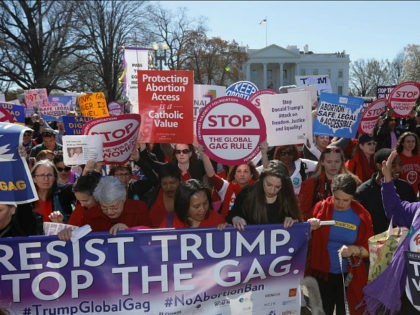 Activists march past the White House as part of 'A Day Without a Woman' strike on International Women's Day in Washington, U.S., March 8, 2017. REUTERS/Kevin Lamarque