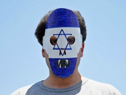 """An Iranian demonstrator wears an anti Israeli mask during an annual pro-Palestinian rally marking Al-Quds (Jerusalem) Day in Tehran, Iran, Friday, July 10, 2015. Tens of thousands of Iranians took part in an annual pro-Palestinian rally in Tehran, chanting """"Down with America"""" and """"Death to Israel."""" Iran does not recognize …"""