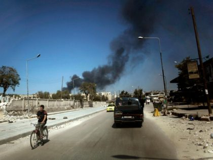 In this Sunday, Sept. 23, 2012 file photo, black smoke leaps the air from government shelling in a residential area in Aleppo, Syria. The Syrian government's decision to detain peaceful activists, in a way left the door open for more extremist elements to rise up. When the protests started in …