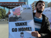 A group of young Turks stage an anti-US protest outside the Parliament before a visit by US Secretary of Defense Ash Carter in Ankara, Turkey, Frday, Oct. 21, 2016. Carter met with President Recep Tayyip Erdogan and other top leaders and defense officials in Ankara amid escalating tensions between Turkey …