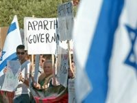 Israelis hold signs as they demonstrate against what they call an 'Apartheid Government' outside Prime Minister Ariel Sharon's offices during the weekly cabinet meeting following its decision a week ago to bar Arabs from acquiring land in Jewish communities built on state property July 14, 2002 in Jerusalem, Israel. Bowing …