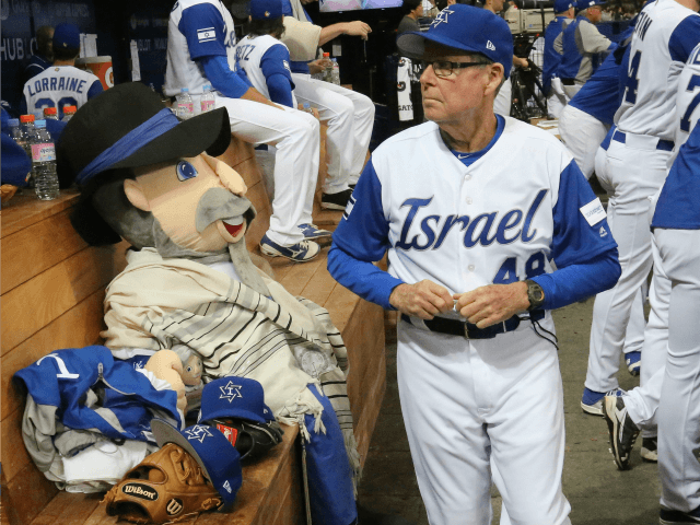 Israel's third base coach Pat Doyle, right, passes by his team mascot, The Mensch on the Bench, during at the first round game of the World Baseball Classic at Gocheok Sky Dome in Seoul, South Korea, Thursday, March 9, 2017. (AP Photo/Ahn Young-joon)