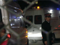 Seen through the hospital gates, an ambulance is escorted, believed to be carrying the bodies of two western journalists, Marie Colvin and Remi Ochlik, arriving late Friday March 2, 2012, to Alassad University Hospital in Damascus, Syria, after having been delivered earlier Friday by Syrian authorities to the International Committee …