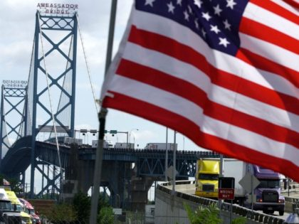 trucks head to US customs after crossing the Ambassador Bridge that connects Detroit, Michigan, and Windsor, Ontario, Canada, 28 September 2001. The Ambassador Bridge is one of the busiest crossings between the US and Canada. The 11 September 2001 terrorist attacks in New York and outside Washington that have left …