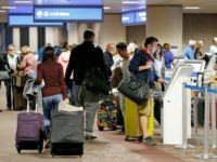 Thanksgiving holiday travelers check in at Phoenix Sky Harbor Airport Wednesday, Nov. 23, 2016, in Phoenix. (AP Photo/Ross D. Franklin)