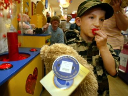 Andrew Perales, 7, of St. John, Mo., whose uncle is currently serving in Iraq with the Army, kisses a fabric heart before placing it into a stuffed bear at Build-A-Bear Workshop in St. Louis, Saturday, May 15, 2004. St. Louis-based Build-A-Bear donated 40,000 stuffed bears made by the public to …