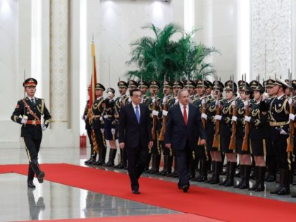 Israeli Prime Minister Benjamin Netanyahu, right, and Chinese Premier Li Keqiang review an honor guard during a welcome ceremony at the Great Hall of the People in Beijing, Monday, March 20, 2017. (AP Photo/Andy Wong)