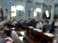 A crucifix is seen as Palestinian Christians pray in the Deir Al Lateen Catholic Church in Gaza City, Sunday, Sept. 17, 2006. Two West Bank churches were set afire early Sunday as a wave of Muslim anger over comments by Pope Benedict XVI construed as anti-Islam grew throughout the Palestinian …