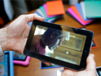 In this Wednesday, Sept. 16, 2015, photo, a video is played on Amazon's new $50 Fire tablet, on display in San Francisco. Amazon.com is introducing the $50 tablet computer in its latest attempt to boost its online store sales by luring consumers who can't afford more expensive Internet-connected devices made …