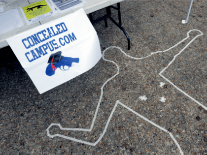 Signs and a replica of a crime scene draw attention to a booth on the campus of Texas State University-San Marcos in San Marcos, Texas, Monday, Nov. 19, 2007. A group at the school are among 8,000 students nationwide who have joined the non-partisan Students for Concealed Carry on Campus, …
