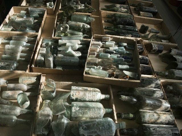 This undated photo provided by the Israel Antiquities Authority on Wednesday, March 22, 2017, shows century-old liquor bottles that belonged to British soldiers in World War I. The Israel Antiquities Authority said Wednesday it was excavating 250,000-year-old flint tools when the archaeologists stumbled upon hundreds of liquor bottles near a …