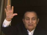 FILE - In this April 25, 2016 file photo, ousted Egyptian President Hosni Mubarak waves to his supporters from his room at the Maadi Military Hospital, where he is hospitalized, as they celebrate Sinai Liberation Day that marks the final withdrawal of all Israeli military forces from Egypt's Sinai Peninsula …