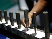 Silencers are on display at the Sig Sauer booth at the Shooting, Hunting and Outdoor Trade Show, Tuesday, Jan. 19, 2016, in Las Vegas. (AP Photo/John Locher)
