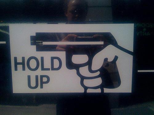 gun warning sign (evan p. cordes / Flickr / CC)