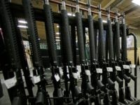 In this April 10, 2013 file photo, newly made AR-15 rifles stand in a rack at Stag Arms in New Britain, Conn. The gun manufacturing company pleaded guilty Tuesday, Dec. 22, 2015, in federal court in Hartford, Conn., to violating federal firearms laws. Owner Mark Malkowski has agreed to sell …