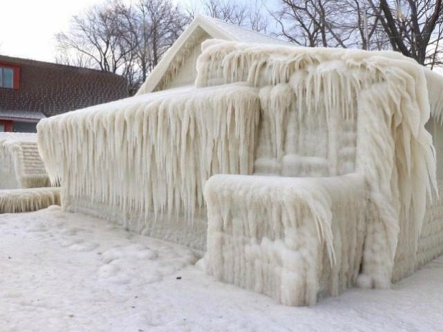 A home on Lake Ontario in Webster, New York, was covered in ice after several days of freezing temperatures combined with winds and moisture from the lake.