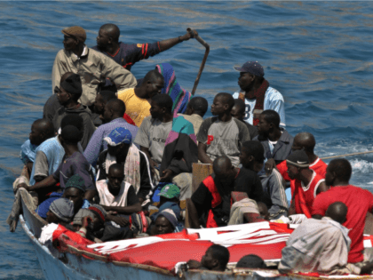 Would-be immigrants arrive on the Canary Island of Tenerife in a small boat near the Puerto de Los Cristianos Wednesday May 17, 2006. Over 133 immigrants arrived in Tenerife Wednesday in two separate boats and over the weekend, nearly 1,000 Africans, the highest volume over a two-day period this year, …