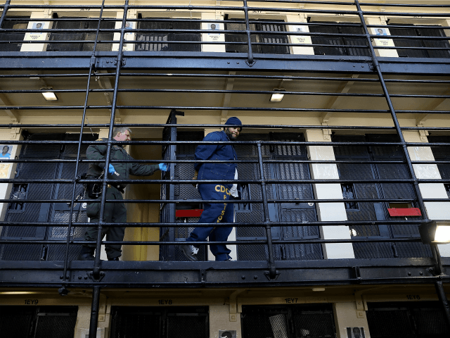 A California Department of Corrections and Rehabilitation (CDCR) officer escorts a condemned inmate from his cell at San Quentin State Prison's death row on August 15, 2016 in San Quentin, California. San Quentin State Prison opened in 1852 and is California's oldest penitentiary. The facility houses the state's only death …