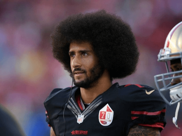 colin kaepernick 7 of the san francisco 49ers stands on the sidelines during their nfl