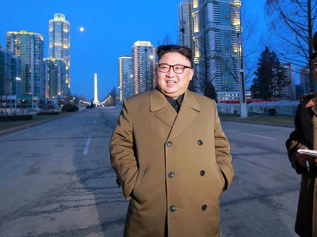 This undated picture released by North Korea's official Korean Central News Agency (KCNA) on March 16, 2017 shows North Korean leader Kim Jong-Un (C) visiting construction sites of Ryomyong street in Pyongyang. / AFP PHOTO / KCNA VIA KNS / STR / South Korea OUT / REPUBLIC OF KOREA OUT ---EDITORS NOTE--- RESTRICTED TO EDITORIAL USE - MANDATORY CREDIT 'AFP PHOTO/KCNA VIA KNS' - NO MARKETING NO ADVERTISING CAMPAIGNS - DISTRIBUTED AS A SERVICE TO CLIENTS THIS PICTURE WAS MADE AVAILABLE BY A THIRD PARTY. AFP CAN NOT INDEPENDENTLY VERIFY THE AUTHENTICITY, LOCATION, DATE AND CONTENT OF THIS IMAGE. THIS PHOTO IS DISTRIBUTED EXACTLY AS RECEIVED BY AFP. / (Photo credit should read STR/AFP/Getty Images)