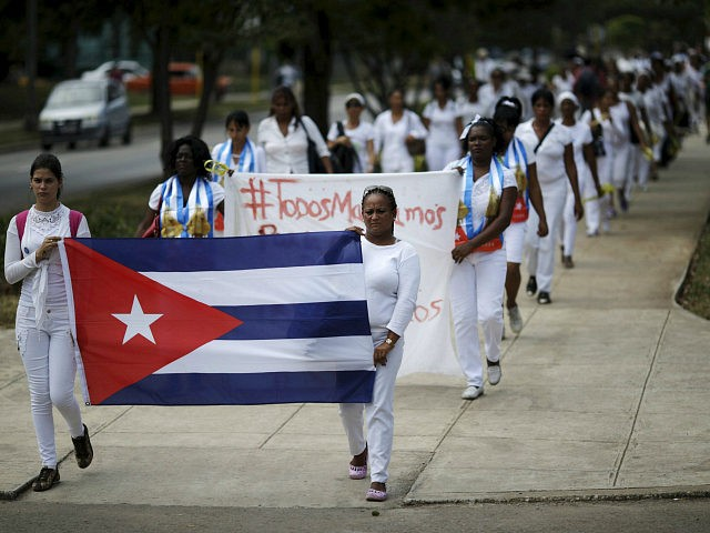 Members of the 'Ladies in White' dissident group march in Havana, March 20, 2016. REUTERS/Ueslei Marcelino