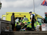 "Emergency services staff provide medical attention close to the Houses of Parliament in London, Wednesday, March 22, 2017. London police say they are treating a gun and knife incident at Britain's Parliament ""as a terrorist incident until we know otherwise."" Officials say a man with a knife attacked a police …"
