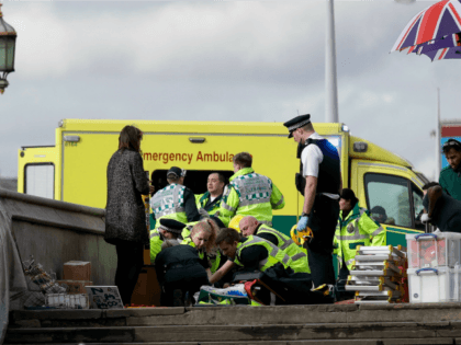 """Emergency services staff provide medical attention close to the Houses of Parliament in London, Wednesday, March 22, 2017. London police say they are treating a gun and knife incident at Britain's Parliament """"as a terrorist incident until we know otherwise."""" Officials say a man with a knife attacked a police …"""