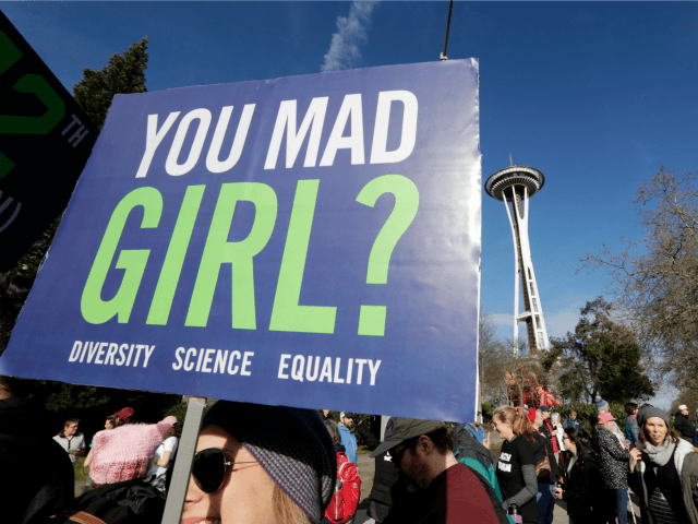 Protesters fill the street and pass the Space Needle during a women's march that brought tens of thousands Saturday, Jan. 21, 2017, in Seattle. Women across the Pacific Northwest marched in solidarity with the Women's March on Washington and to send a message in support of women's rights and other …