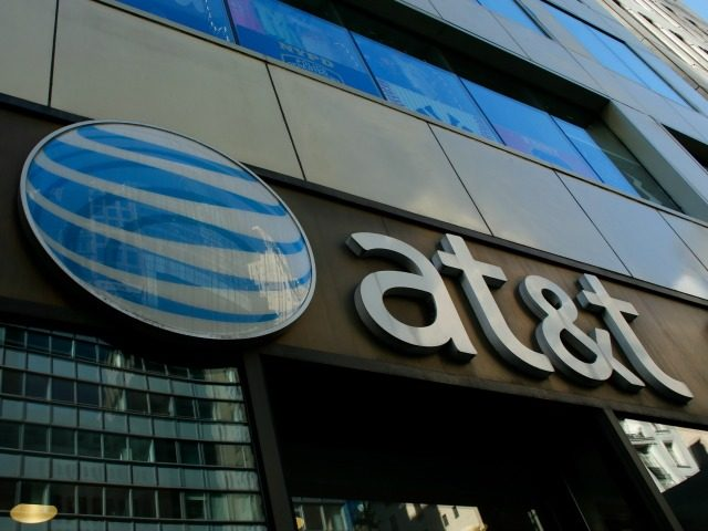 An AT&T store is seen on 5th Avenue in New York on October 23, 2016. AT&T unveiled a mega-deal for Time Warner that would transform the telecom giant into a media-entertainment powerhouse positioned for a sector facing major technology changes. The stock-and-cash deal is valued at $108.7 billion including debt, …