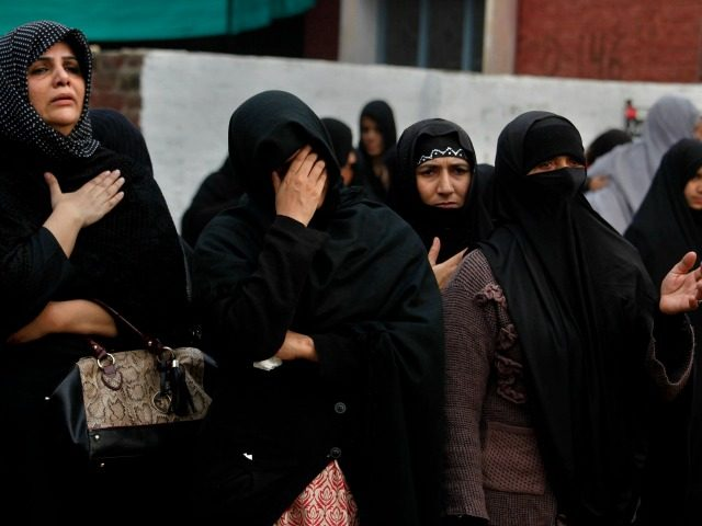 Pakistani Shiite Muslim women mourn during a procession marking Chehlum in Islamabad, Pakistan, Sunday, Nov. 20, 2016. Chehlum, traditionally marks a period of mourning for the death of Imam Hussain, grandson of Prophet Muhammad. (AP Photo/Anjum Naveed)