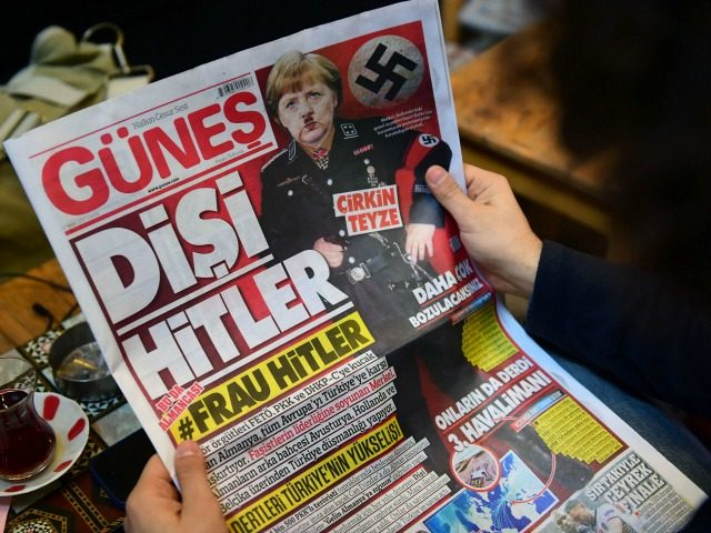 A man reads an issue of Gunes, a Turkish pro-government daily newspaper, with on its front page German Chancellor Angela Merkel depicted in Nazi uniform with a Hitler-style moustache, labelling the German leader 'She Hitler', on March 17, 2017 in Istanbul, Turkey. Right-wing tabloid-style daily Gunes ('Sun') printed the picture …